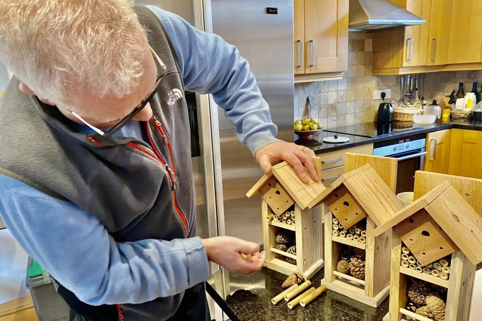 Volunteer Gareth making bird boxes